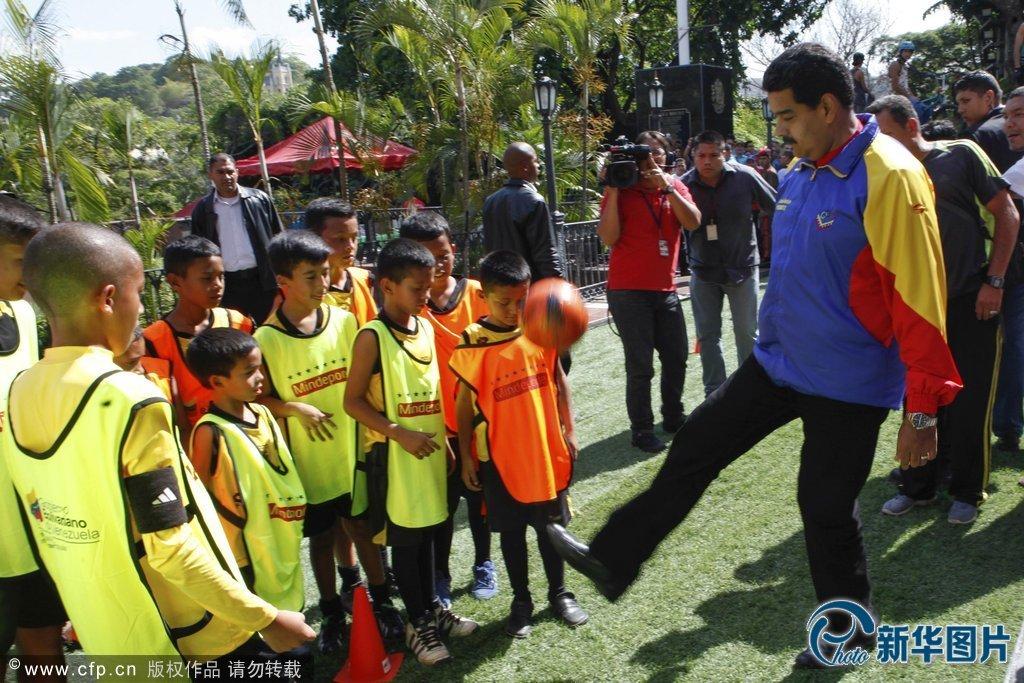 Venezuela's President Nicolas Maduro plays soccer with children at Miraflores Palace in Caracas